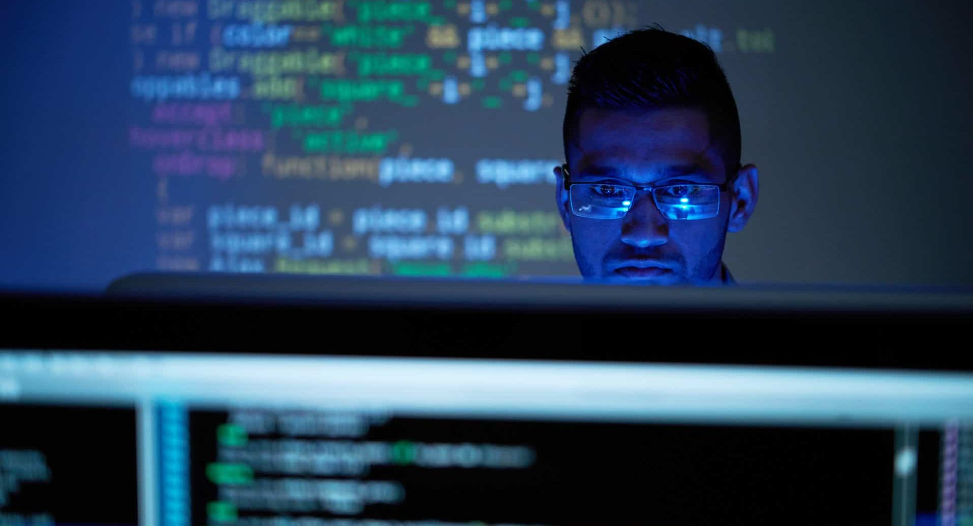 Face of programmer working in office of It company